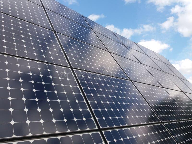 Solar panels against blue skies stock images