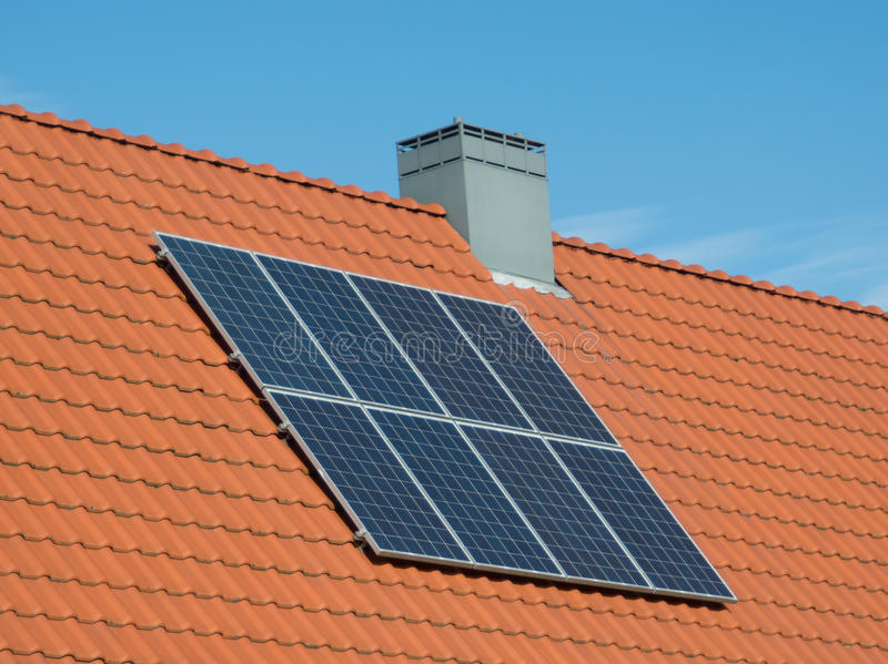 Solar panels small house. Solar panels on the roof of a small house stock photo
