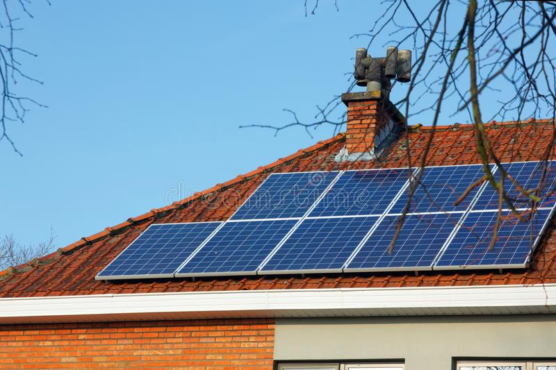 Solar panels on a tiled roof royalty free stock photos