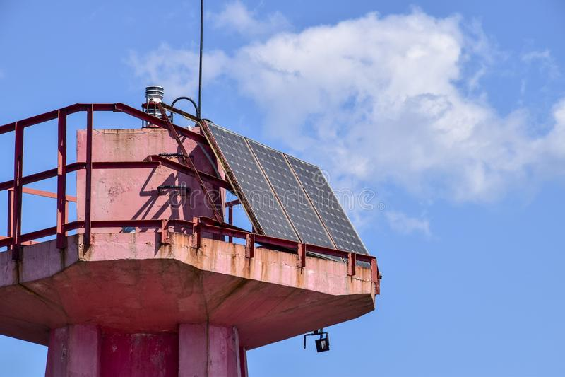 Solar panels at the top of the lighthouse. Transformation of solar energy. stock images
