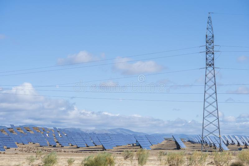 Solar panels with tracker field for generating sustainable energy royalty free stock image