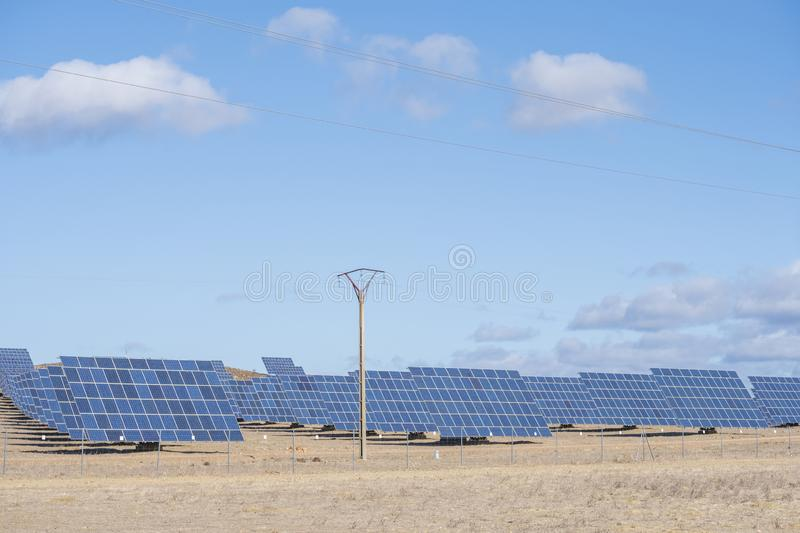 Solar panels with tracker field for generating sustainable energy royalty free stock photo