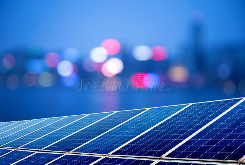 Solar panels. Urban landscape as the background of the solar panel royalty free stock photography