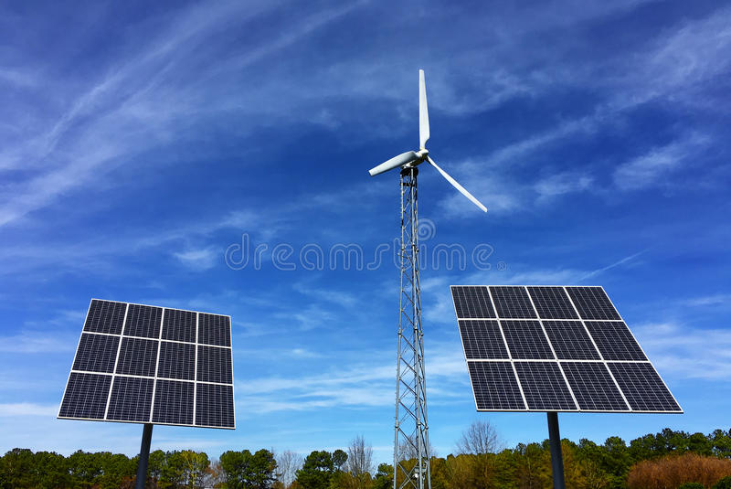 Solar panels and wind energy turbine power station royalty free stock photo