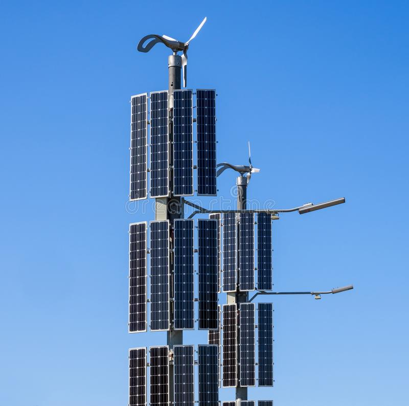 Solar panels and wind generators with LED lights.  stock photography
