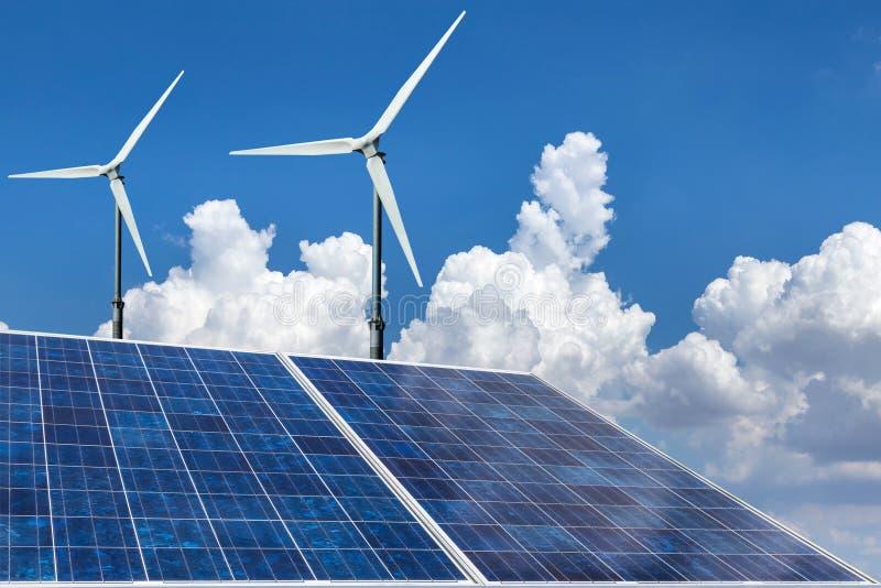 Solar panels and wind turbines alternative energy stock photos