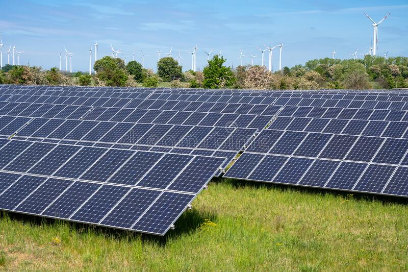Solar panels with wind turbines royalty free stock photography