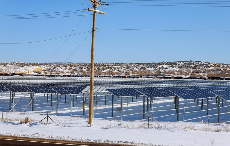 Solar panels in winter view of snow covered solar panel park, photovoltaic power station royalty free stock image