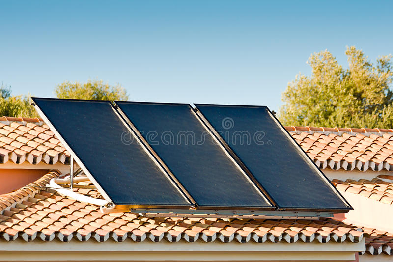 Solar pannels. On a roof royalty free stock photography