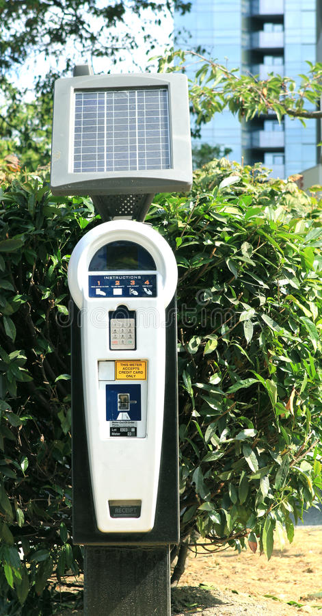 Solar parking meter. On the parking royalty free stock image