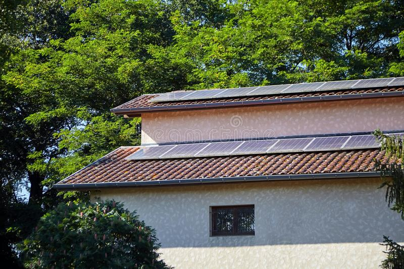 Solar photovoltaic panels installed on a tiled roof for alternative energy royalty free stock image