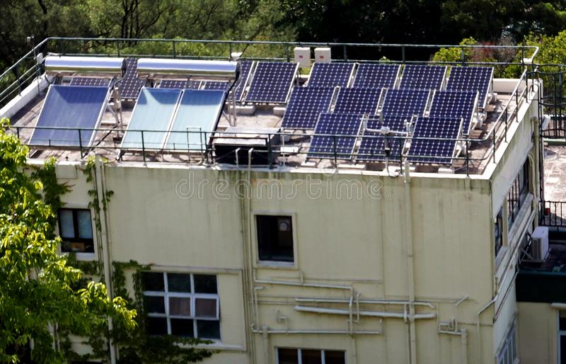 Solar Planes on Top of House in Hong Kong stock images