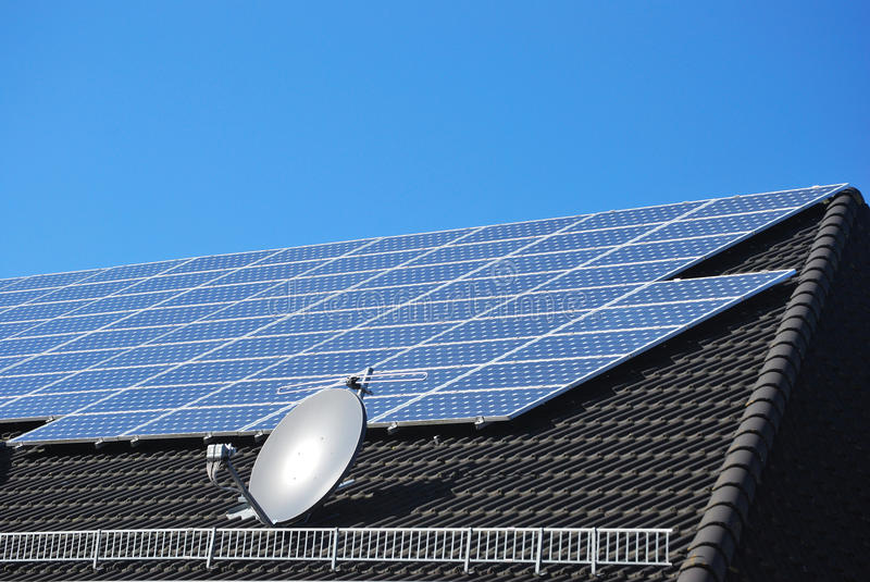 Solar power cells on a black roof royalty free stock photos