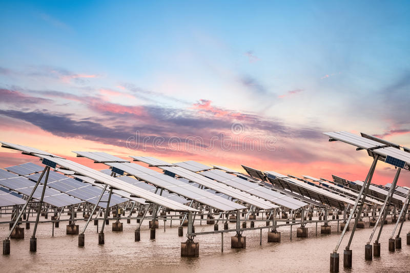 Solar power farm at dusk. Solar power farm in sunset , develops coastal tidal flats and green energy royalty free stock image