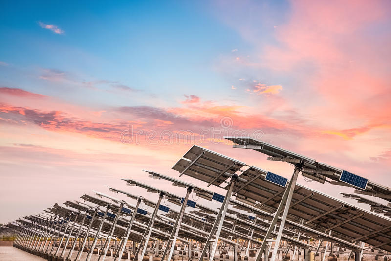 Solar power farm in sunset. Develops coastal tidal flats and green energy concept stock photos