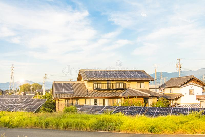 Solar power panels ,Photovoltaic modules for innovation green energy for life. With sunrise background royalty free stock photo