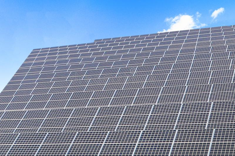 Solar power panels ,Photovoltaic modules for innovation green energy for life. With blue sky background royalty free stock image