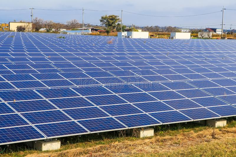 Solar power panels ,Photovoltaic modules for innovation green energy for life with blue sky background royalty free stock photo