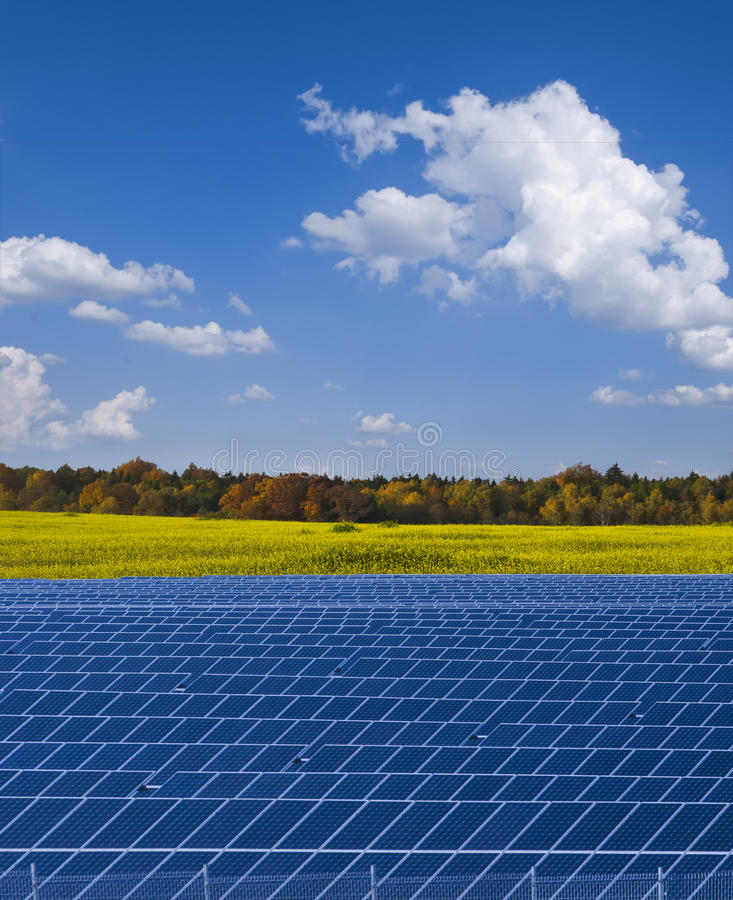 Solar power plant and rapesed field in Germany royalty free stock images