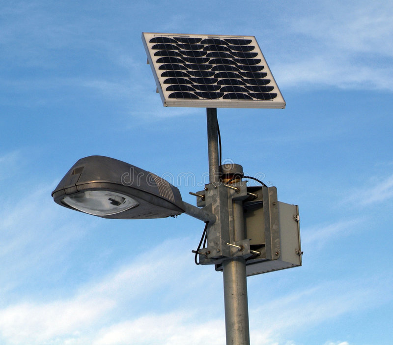 Solar powered lamp post. Lamp post with Solar photovoltaic powered Light and blue sky stock photo