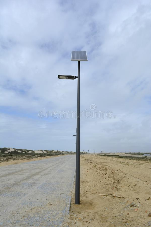 Solar street lamp on a cloudy day royalty free stock image