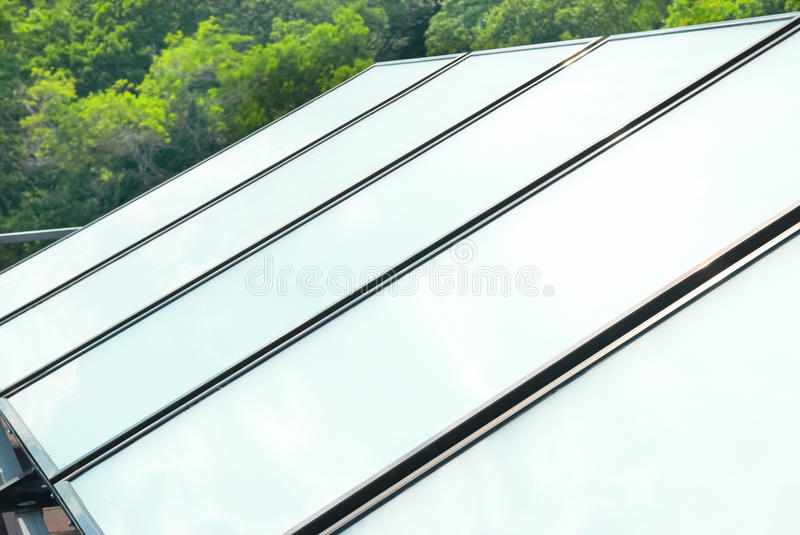 Solar system on the roof. Solar water heating system on the red roof. Gelio panels royalty free stock photos