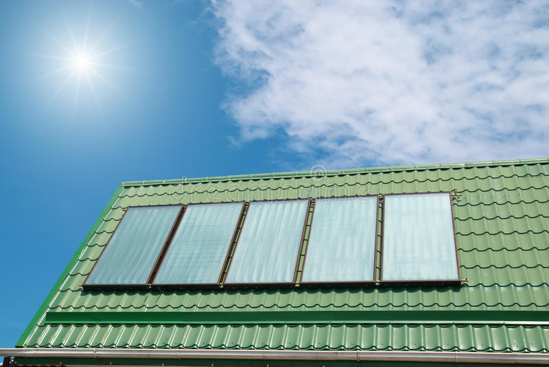 Solar system. Solar water heating system on the roof royalty free stock images