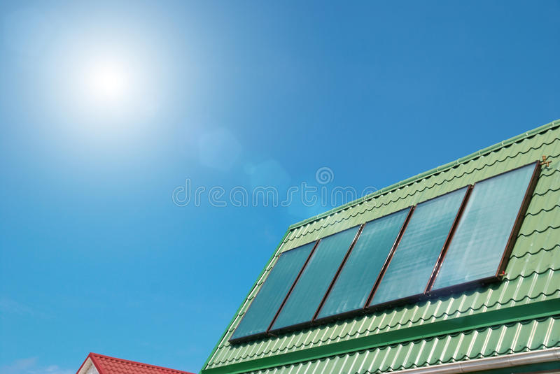 Solar system. Solar water heating system on the roof stock images