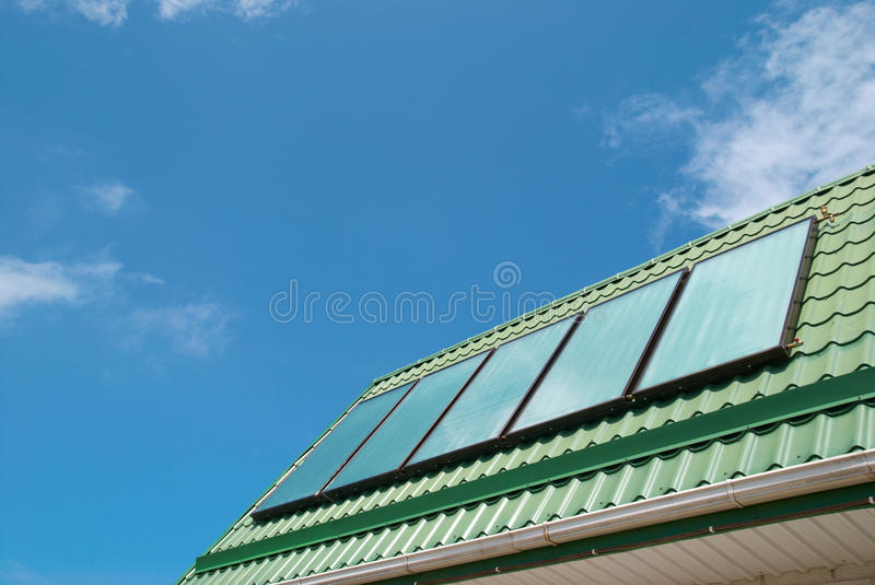 Solar system. Solar water heating system on the roof stock photography