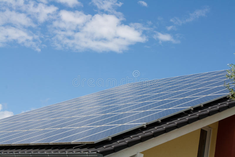 Solar systems on a roof royalty free stock image