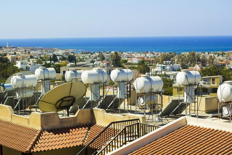Solar systems on roofs of houses. In Paphos, Cyprus royalty free stock photography