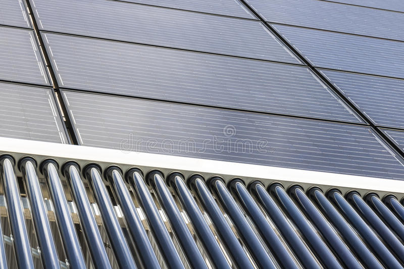 Solar Thermal Flat Panels with Evacuated Tube Collectors. Many companies are installing renewable energy sources I. Solar Thermal Flat Panels with Evacuated Tube stock images