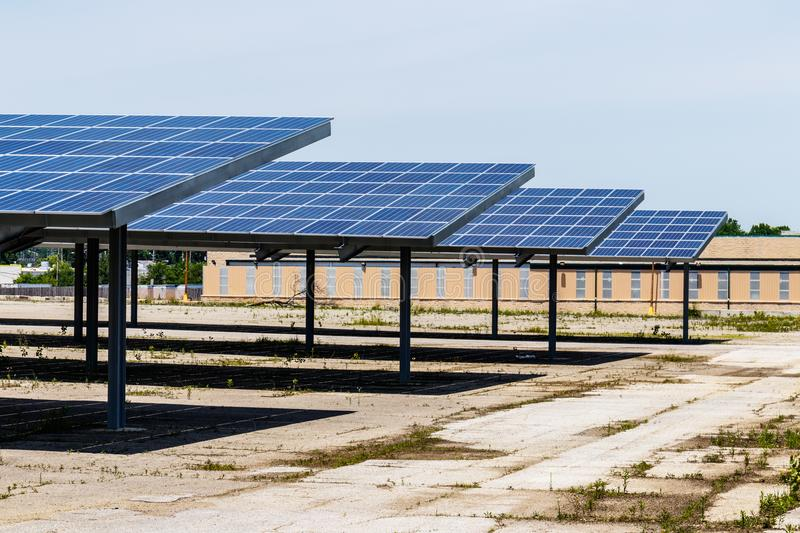 Solar Thermal Flat Panels providing shade in a parking lot. Many companies are installing renewable energy sources I. Solar Thermal Flat Panels providing shade royalty free stock photos
