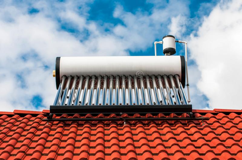 Solar water heater boiler on residentual house rooftop stock image