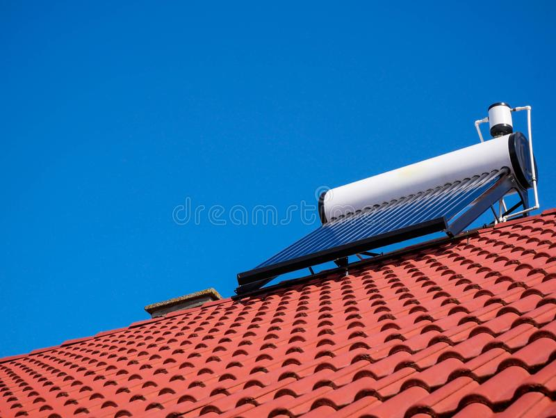 Solar water heater boiler on rooftop, perfect blue sky. On the background stock photography