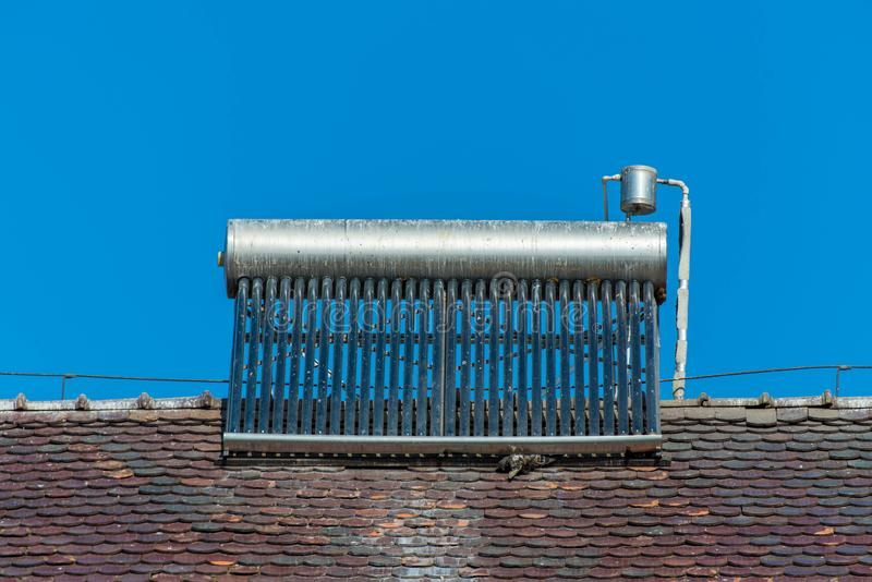 Solar water heater boiler on rooftop, visible bird excrements. On the boiler royalty free stock image