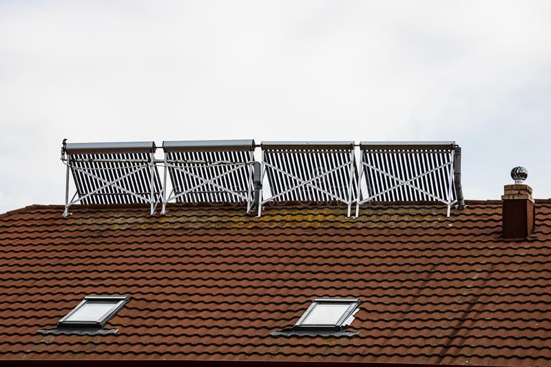 Solar water heater installed on a house roof.  royalty free stock photography