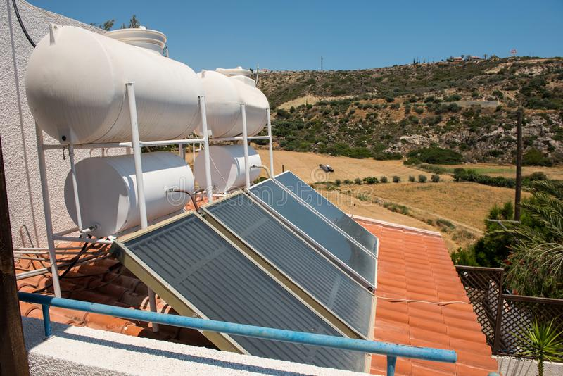 Solar water heater on the roof of a house. Green energy concept. Solar water heater on the roof of a house stock photos