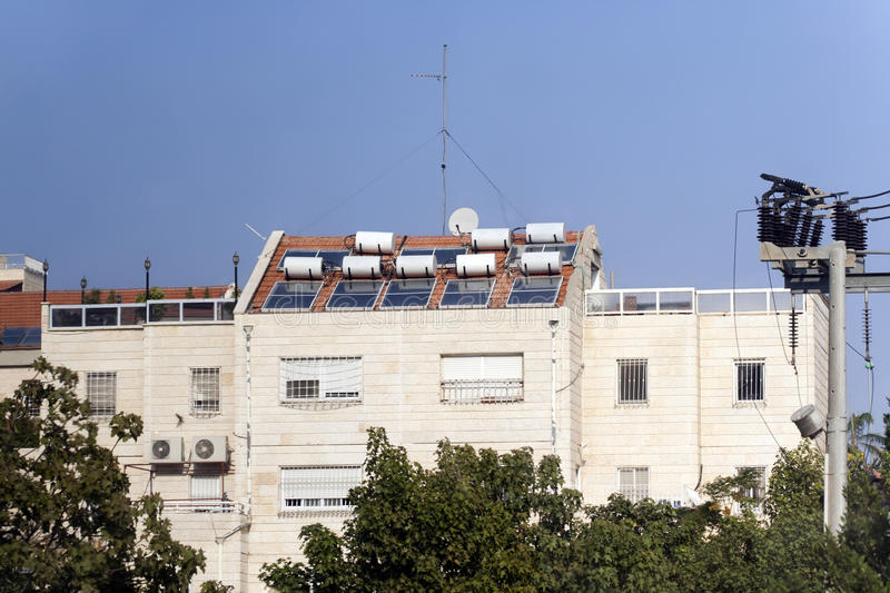 Solar water heater. On the roof. The using of solar energy. Israel, Middle East royalty free stock photography