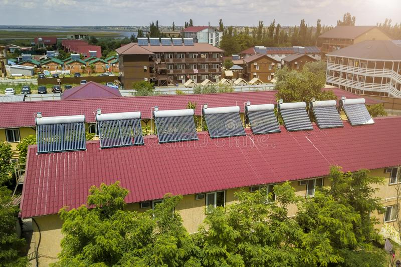 Solar water heaters on the roof of the hotel.  stock image