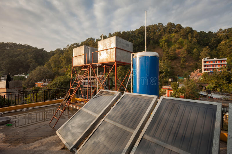 Solar water heating apparatus. On a rooftop in Nepal royalty free stock image
