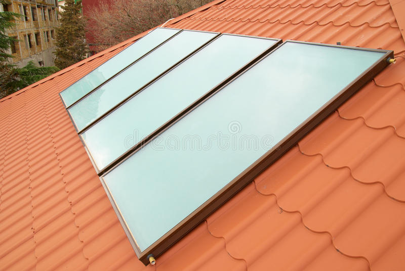 Solar water heating system. (geliosystem) on the red house roof stock photos