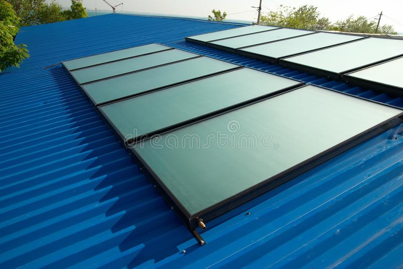 Solar water heating system. On the house roof stock photo