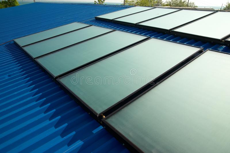 Solar water heating system. On the house roof stock image