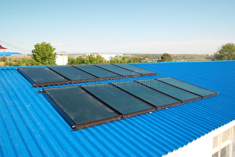 Solar water heating system. On the house roof stock photos