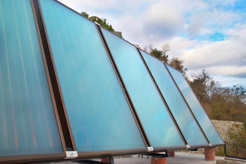 Solar water heating system. On the house roof stock images