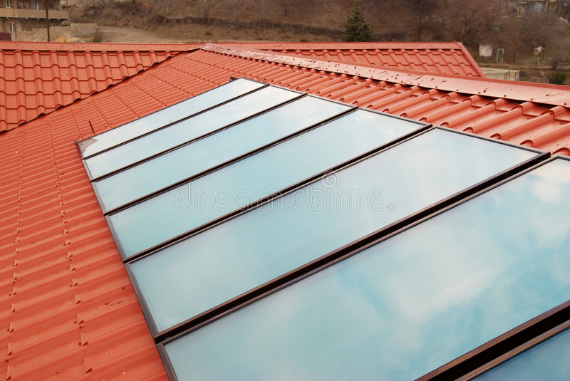 Solar water heating system. (geliosystem) on the red house roof stock photography