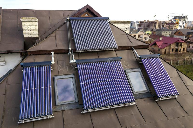 Solar water heating system on house roof. Hot water boiler, alternative ecological sun energy generator royalty free stock images