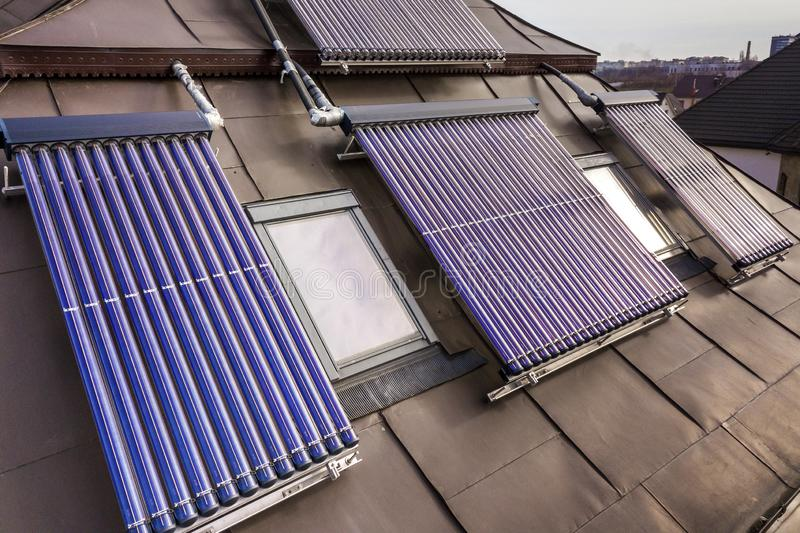 Solar water heating system on house roof. Hot water boiler, alternative ecological sun energy generator. Modern technology concept royalty free stock image