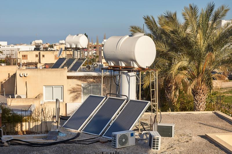 Solar water heating system on a house roof. Modern solar water heating system on a house roof, Paphos Cyprus stock photography
